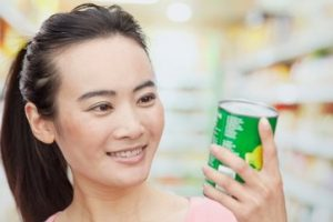 Woman looking at can label